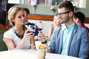 Two 20-somethings enjoy a glass of fine red wine
